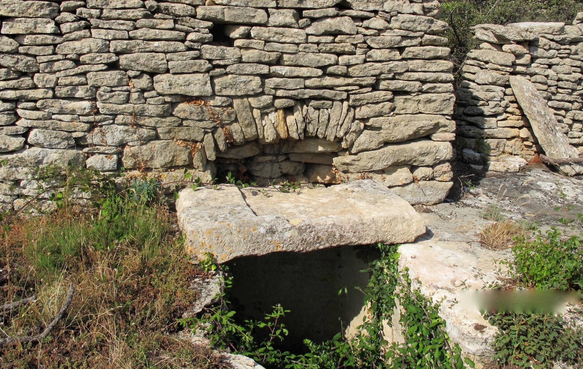 From a hole below the stone slab, wine was poured from the vat into containers
